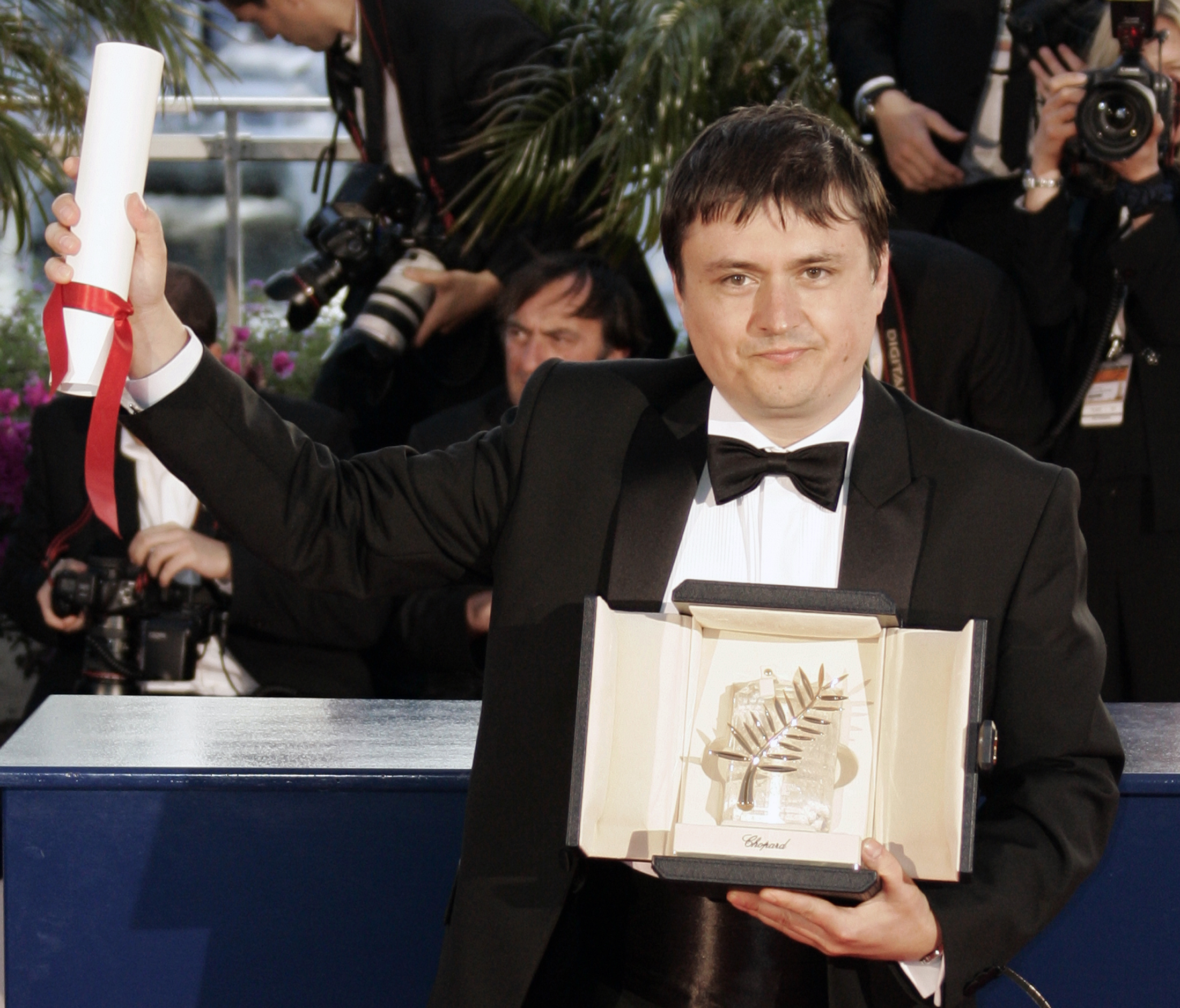 Romanian director Cristian Mungiu holds the Palme d'Or award for his film