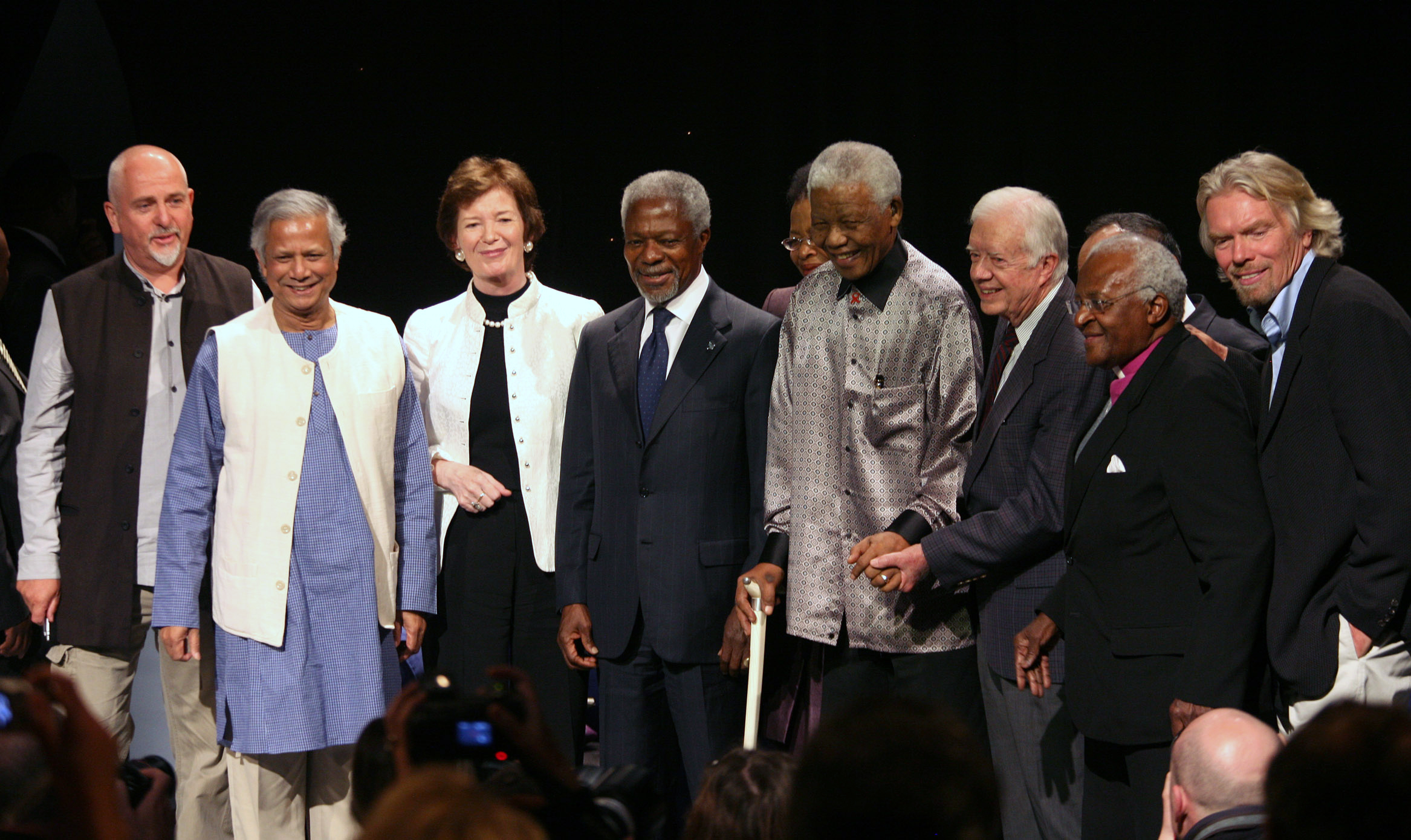 (L-R) Musician and activist Peter Gabriel, Professor Muhammad Yunus, former Pesident of Ireland Mary Robinson, former Secretary General of the U.N. Kofi Annan, former President of South Africa Nelson Mandela, former U.S. President Jimmy Carter, Archbishop Desmont Tutu and entrepreneur Richard Branson pose for photographers during a ceremony marking the 89th birthday of Mandela in Johannesburg July 18 2007. Mandela marked his birthday on Wednesday by launching an international group of elder statesmen, including fellow Nobel peace laureates Desmond Tutu and Jimmy Carter, to tackle the world's problems. REUTERS/Siphiwe Sibeko