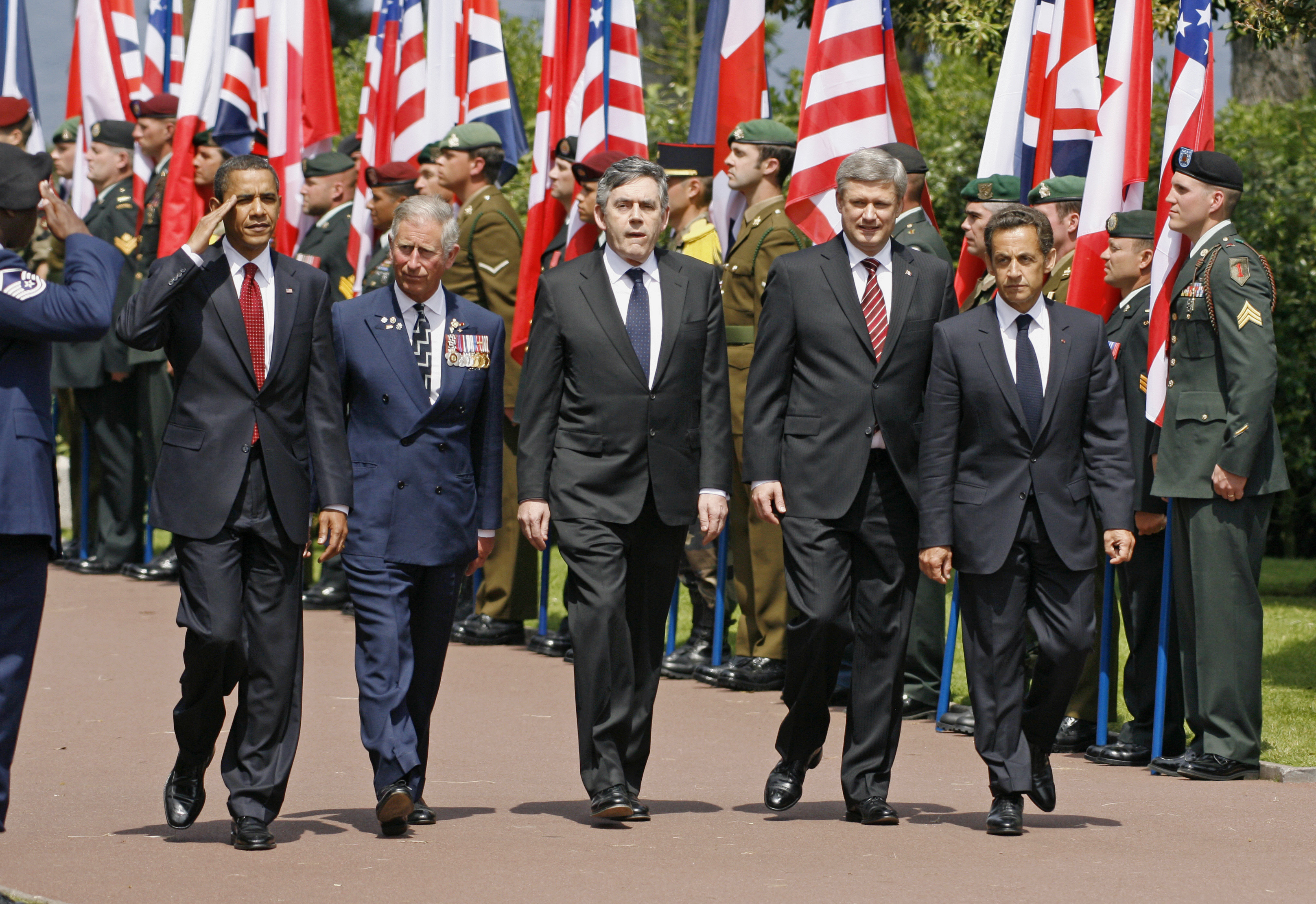 World leaders arrive at the U.S. war cemetery at Colleville-sur-Mer for a ceremony marking the 65th anniversary of the Allied forces D-Day landings at Normandy June 6, 2009. From L-R: U.S. President Barack Obama, Britain's Prince Charles, Britain's Prime Minister Gordon Brown, Canada's Prime Minister Stephen Harper and France's President Nicolas Sarkozy. REUTERS/Mal Langsdon