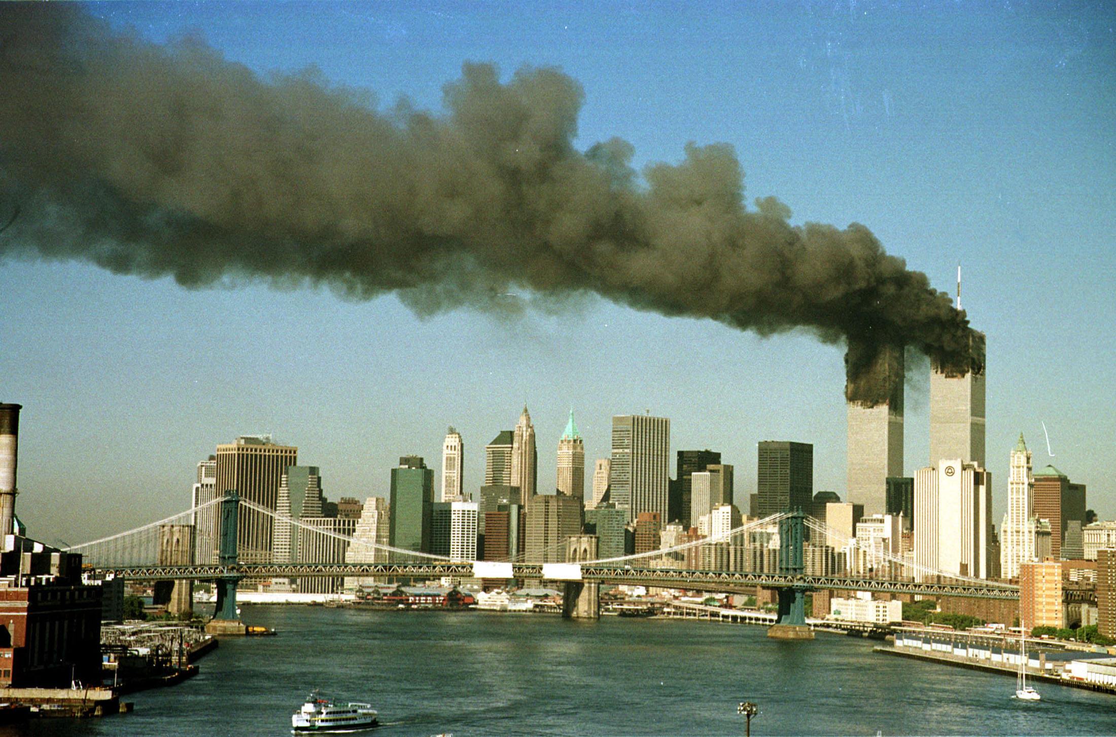The towers of the world trade center billow smoke shortly after being