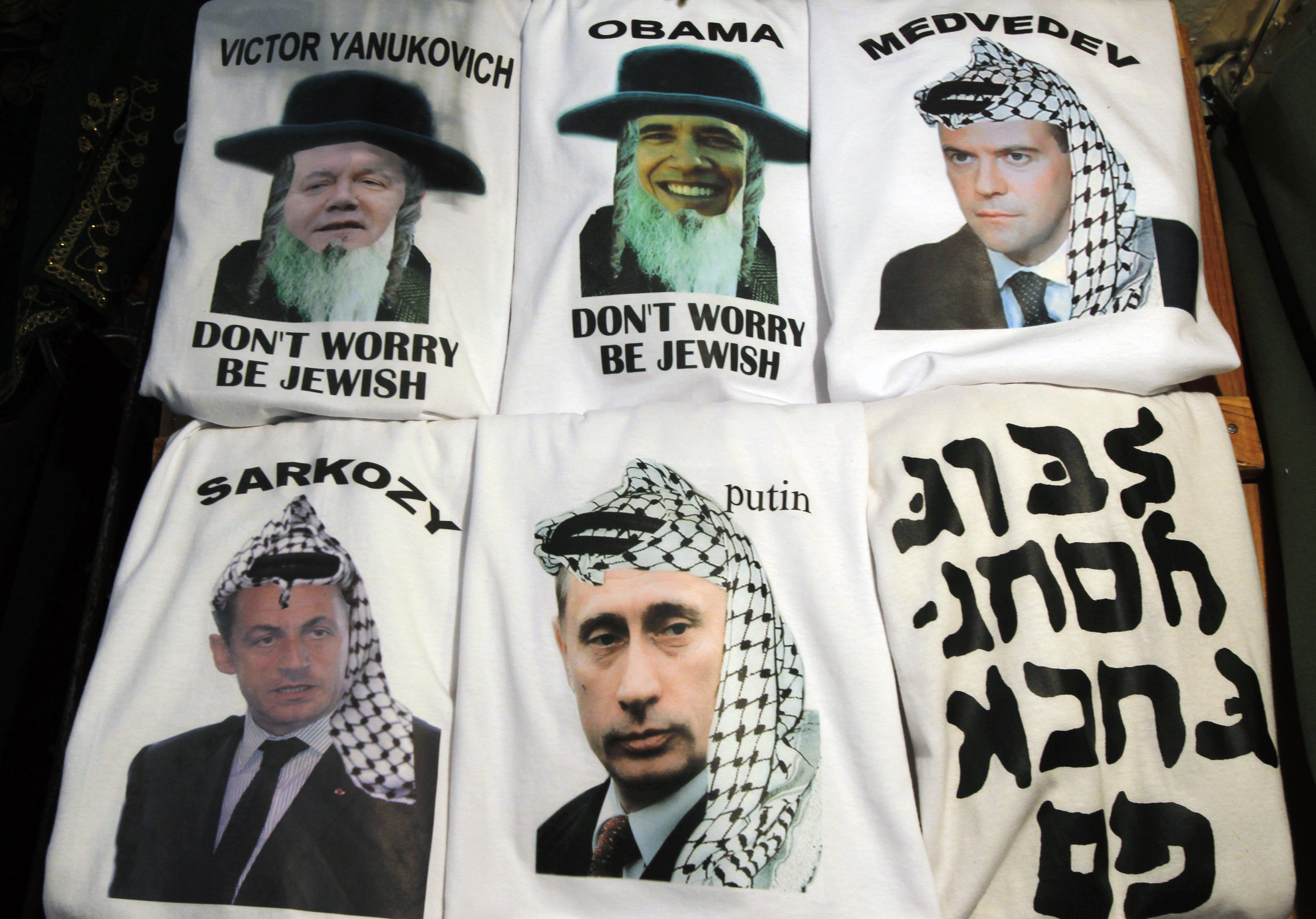 Shirts with the images of U.S. President Barack Obama, Russia's Prime Minister Vladimir Putin and President Dmitry Medvedev, France's President Nicolas Sarkozy and Ukraine's President Viktor Yanukovich are displayed for sale in a market in Jerusalem's Old City September 23, 2011. ©REUTERS/Baz Ratner