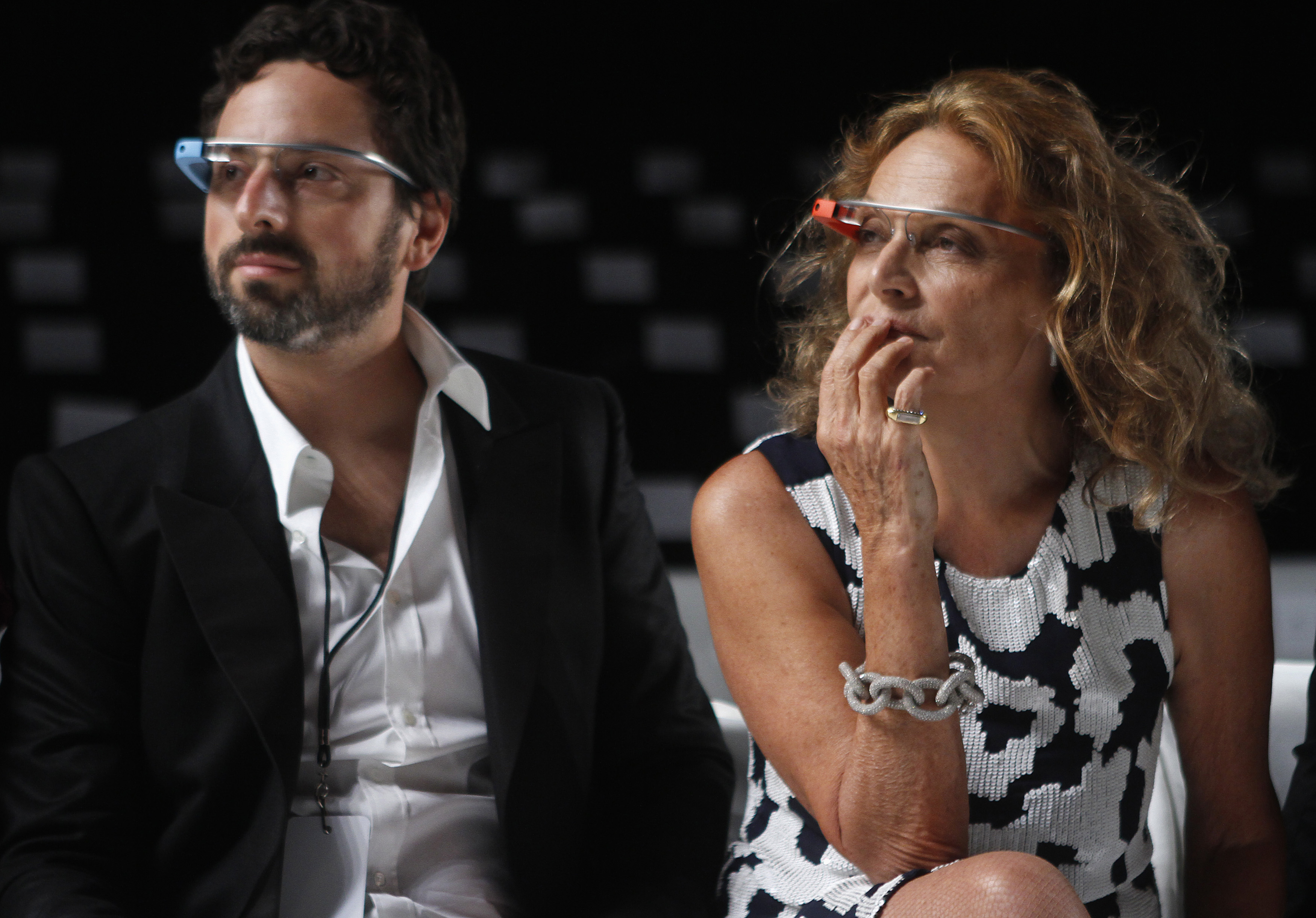 Google founder Sergey Brin (L) and designer Diane von Furstenberg sit and watch the rehearsal for her Spring/Summer 2013 collection show during New York Fashion Week September 9, 2012. The show was used as a launching event for Google's new product
