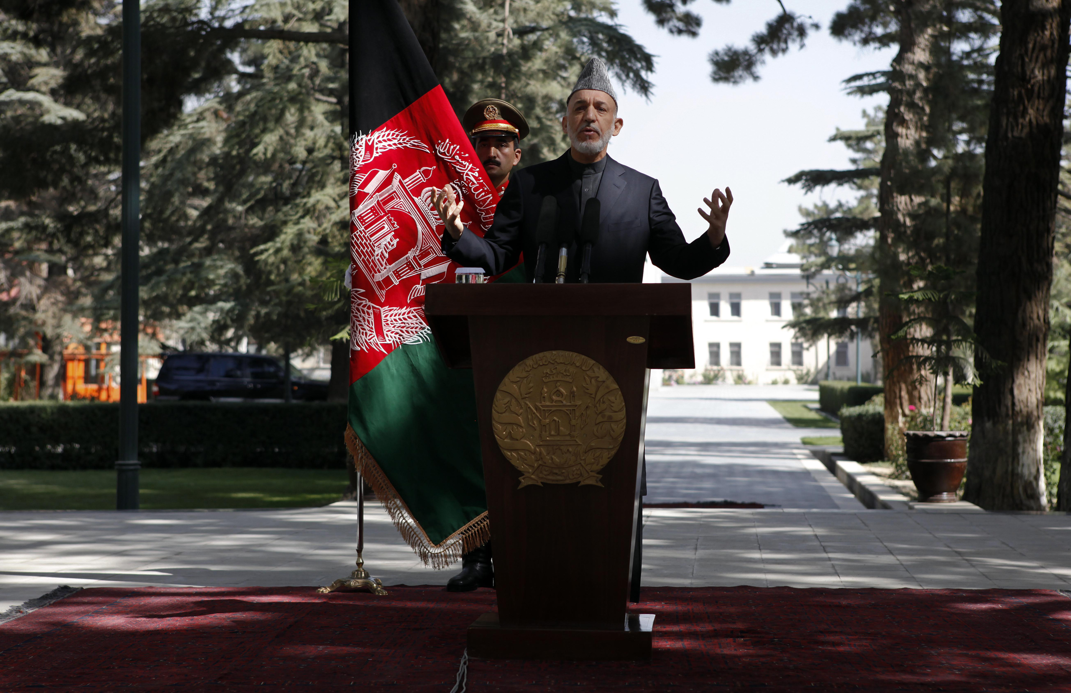 Afghanistan's President Hamid Karzai speaks during a news conference in Kabul October 4, 2012. Karzai said on Thursday that presidential elections in 2014 when his term will end would be on time, despite a continuing insurgency and concerns about a simultaneous NATO combat troop exit. REUTERS/Omar Sobhani