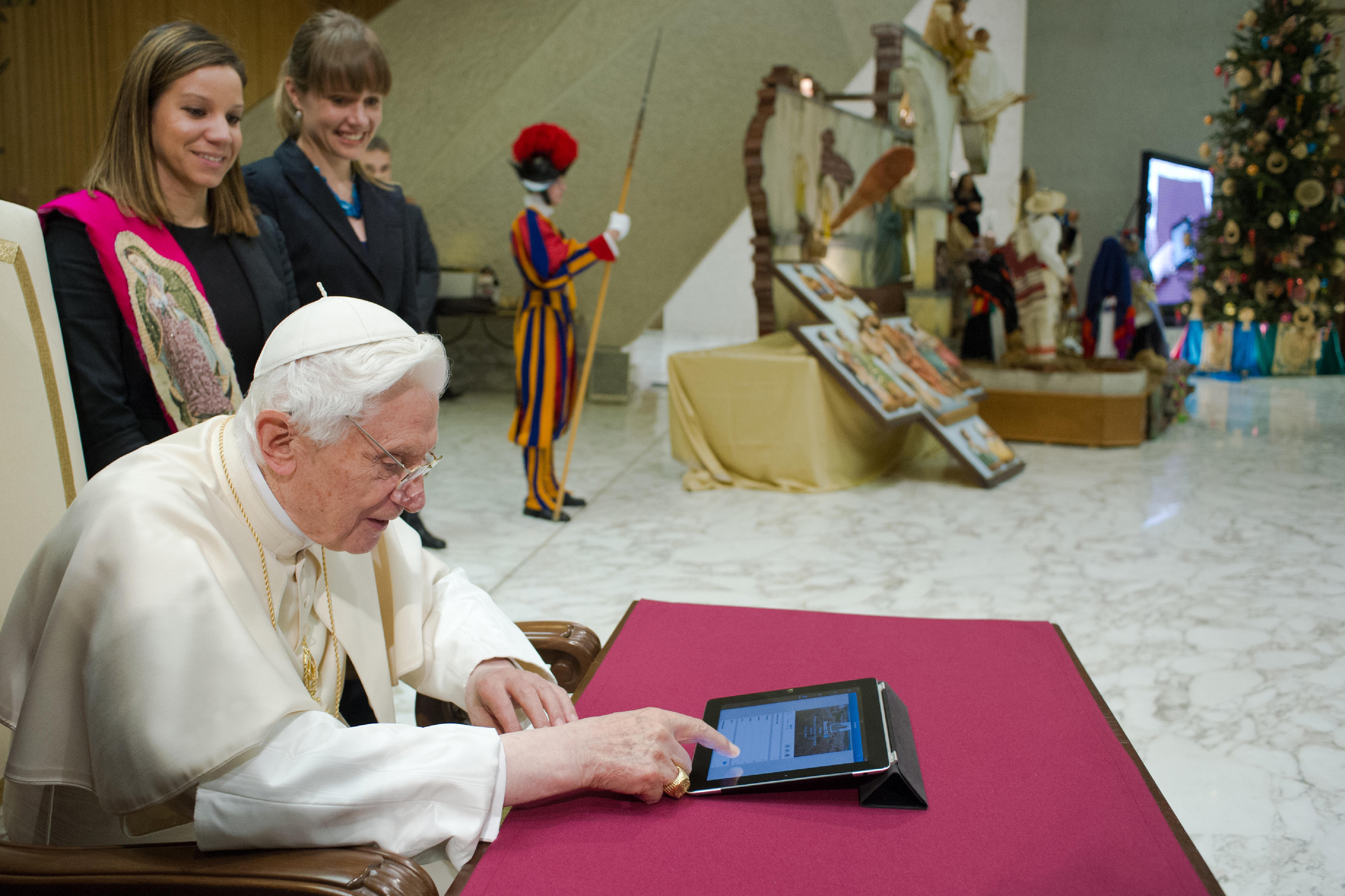 Pope Benedict XVI posts his first tweet using an iPad tablet after his Wednesday general audience in Paul VI's Hall at the Vatican.