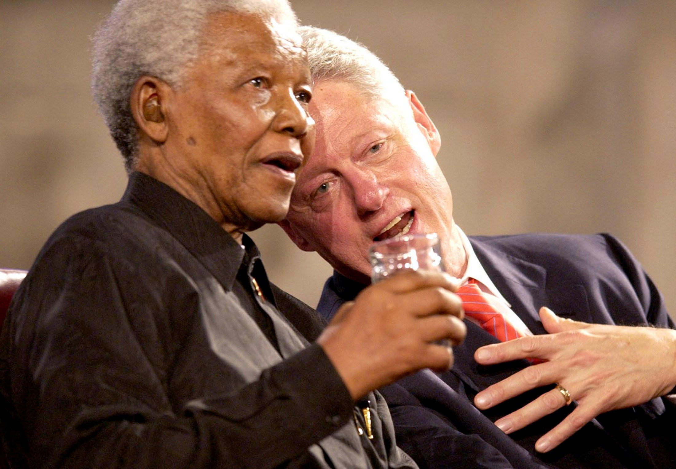 Former U.S President Bill Clinton (R) and former South African President Nelson Mandela (L) speak during a Gala night in Westminster Hall, London, July 2, 2003. The two men and Britain's Prime Minister Tony Blair attended the Gala night on Wednesday to mark the centenary of the Rhodes Trust and the establishment of the Mandela Rhodes Foundation.