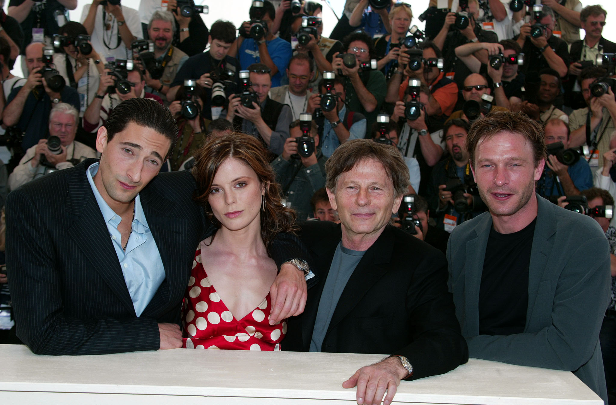 French director Roman Polanski (2nd R) poses for photographers with actors American Adrien Brody (L), Briton Emilia Fox (2nd L) and German Thomas Kreschmann (R) during a photocall for his film