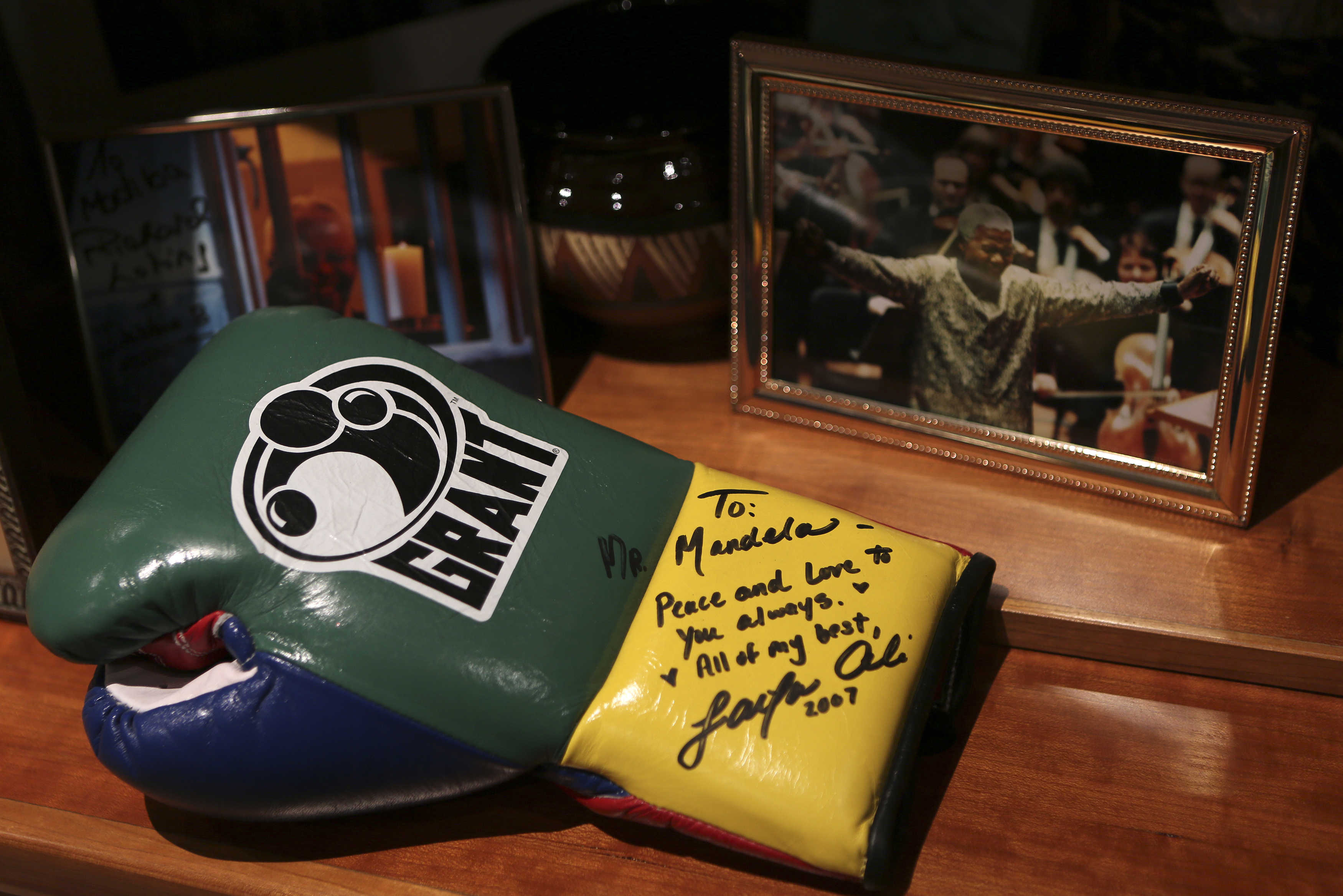 A boxing glove donated and signed by Laila Ali, daughter of retired heavyweight boxing legend Muhammad Ali, is seen at the office of former South African president and anti-apartheid leader Nelson Mandela at the newly renovated Nelson Mandela Centre of Memory in Houghton, Johannesburg, June 11, 2013.
