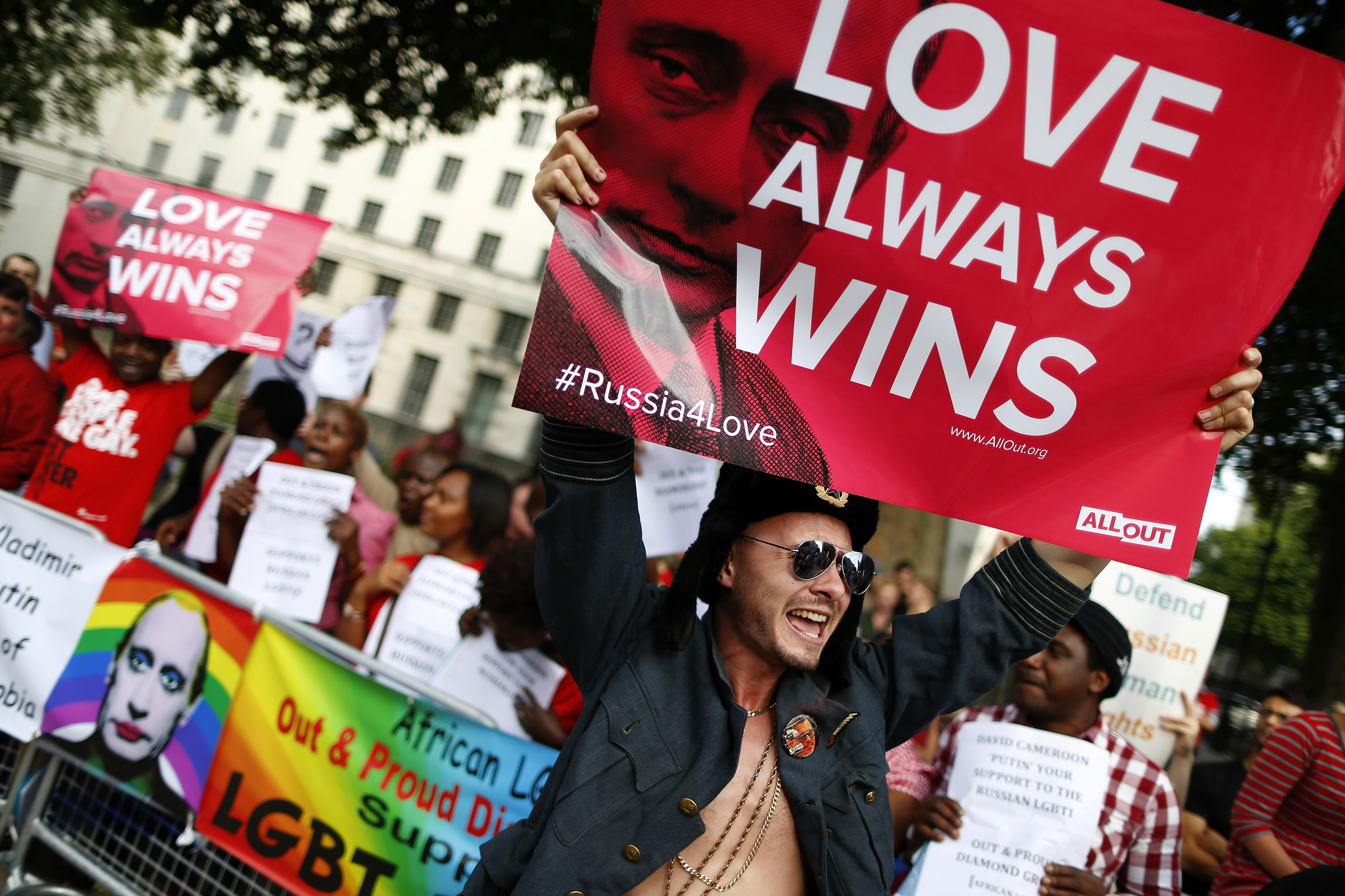 A protester holds up a placard during a demonstration against Russia's anti-gay legislation opposite Downing Street in London