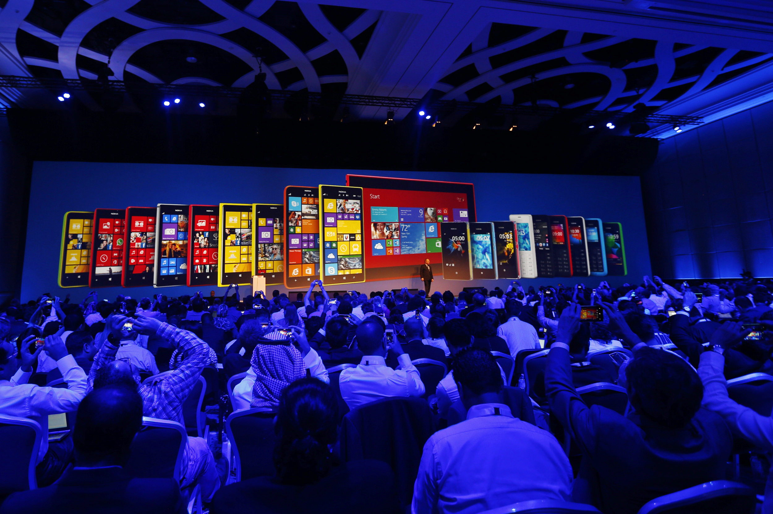 People attend the launch ceremony of Nokia's first tablet and two large-screen smartphones in Abu Dhabi October 22, 2013. Nokia unveiled its first tablet and two large-screen smartphones, known as phablets, at the annual Nokia World event in Abu Dhabi on Tuesday.