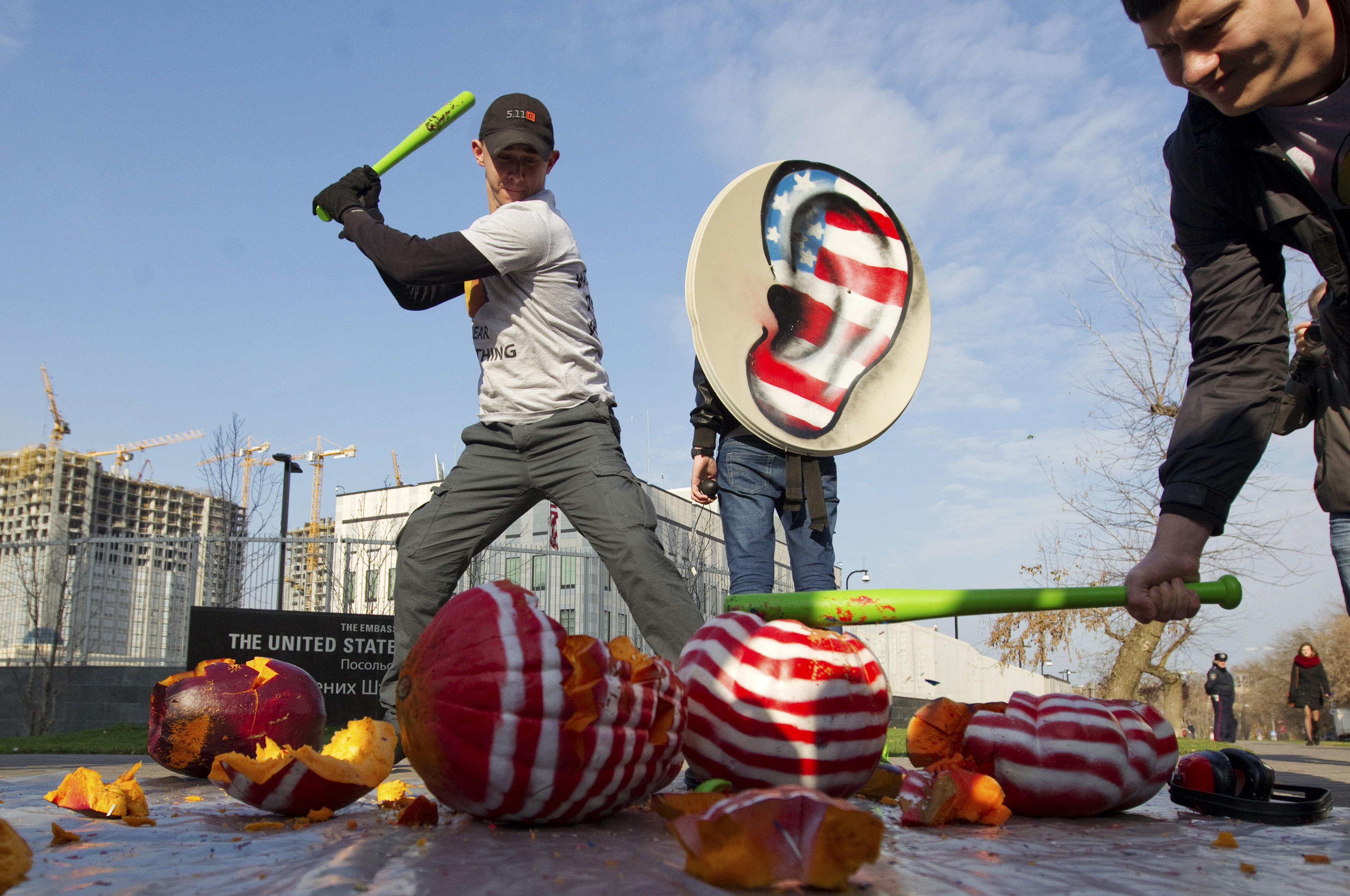 Activists from the Internet Party of Ukraine smash a pumpkin with headphones as they stage a demonstration in front of the U.S. embassy in Kiev.