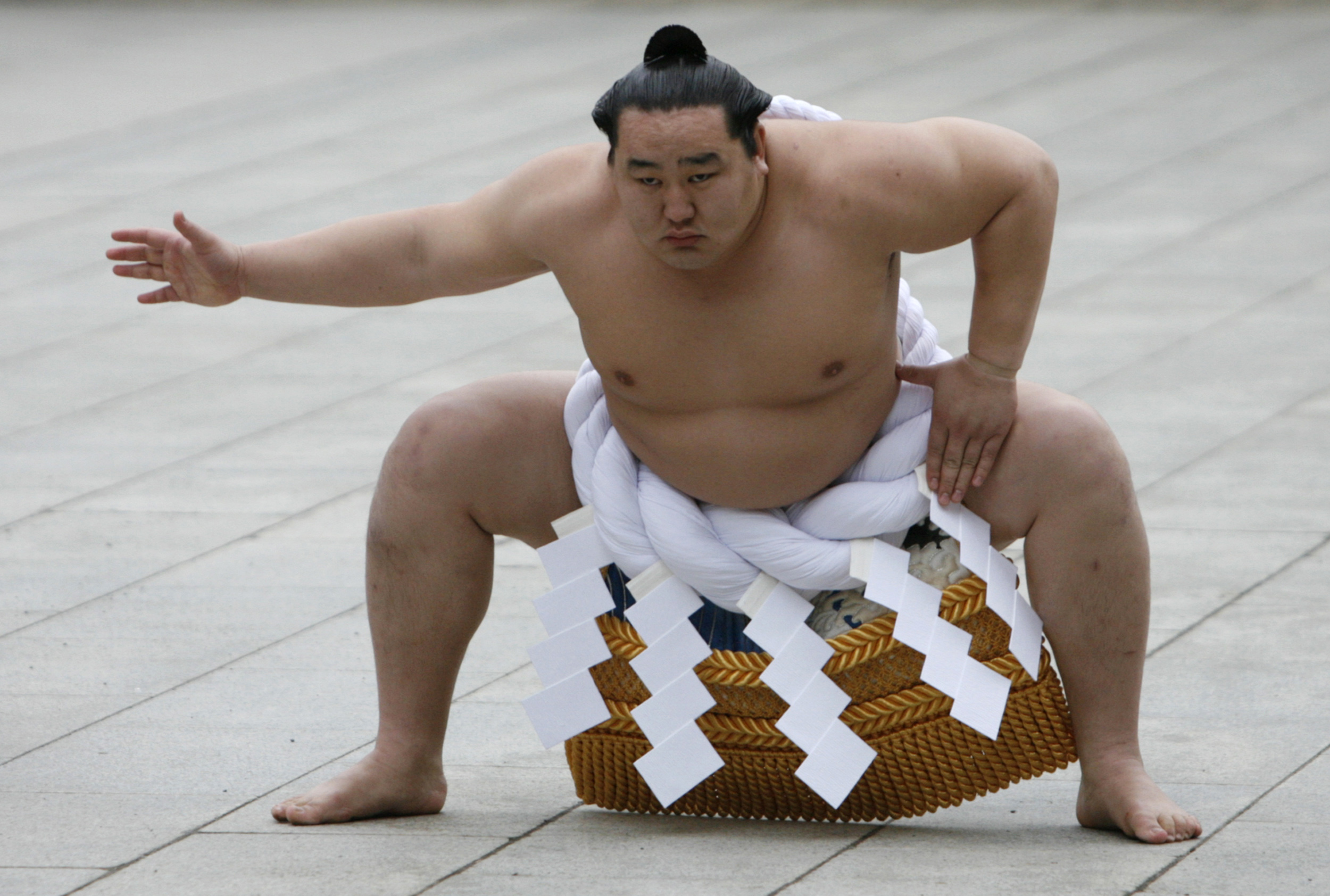 Mongolian-born grand sumo champion Yokozuna Asashoryu wears a ceremonial belly band as he performs a ring-entering ritual at Meiji Shrine in Tokyo January 7, 2008.