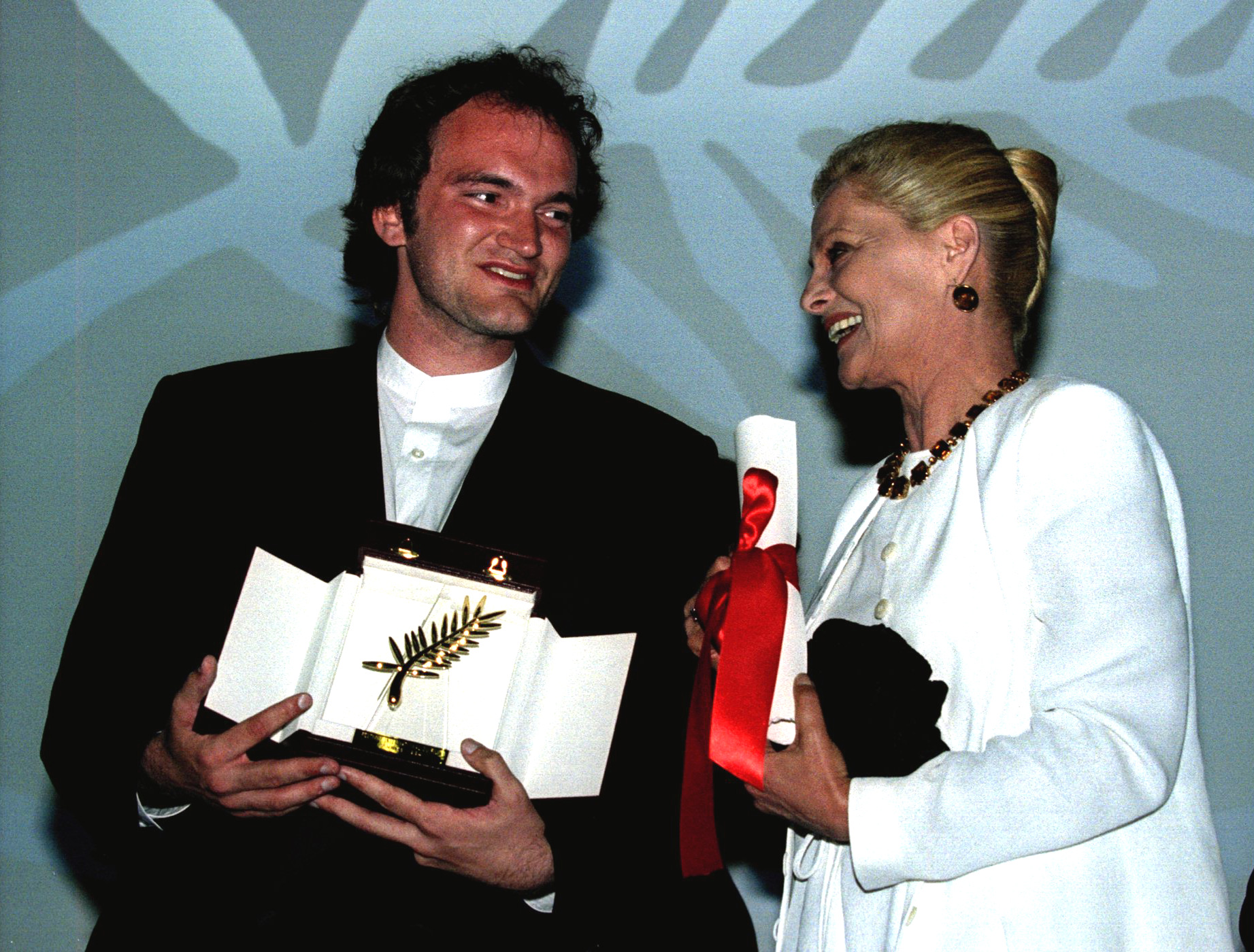 American director Quentin Tarantino (L) holds the Golden Palm for his film