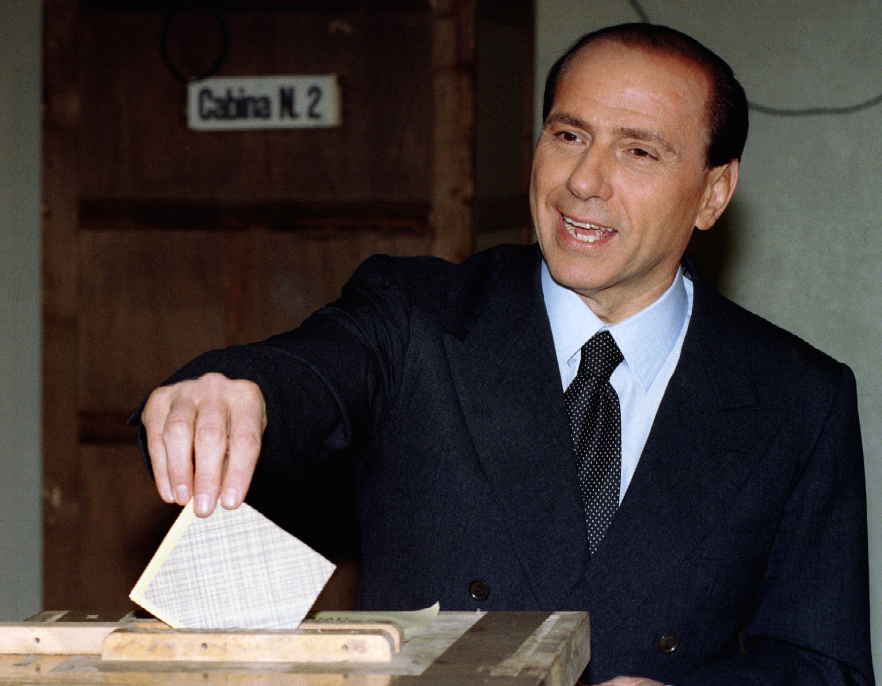 Silvio Berlusconi, leader of the right-wing Forza Italia (Go Italy) party and head of the head of the Freedom Alliance votes in the landmark Italian general elections March 28.