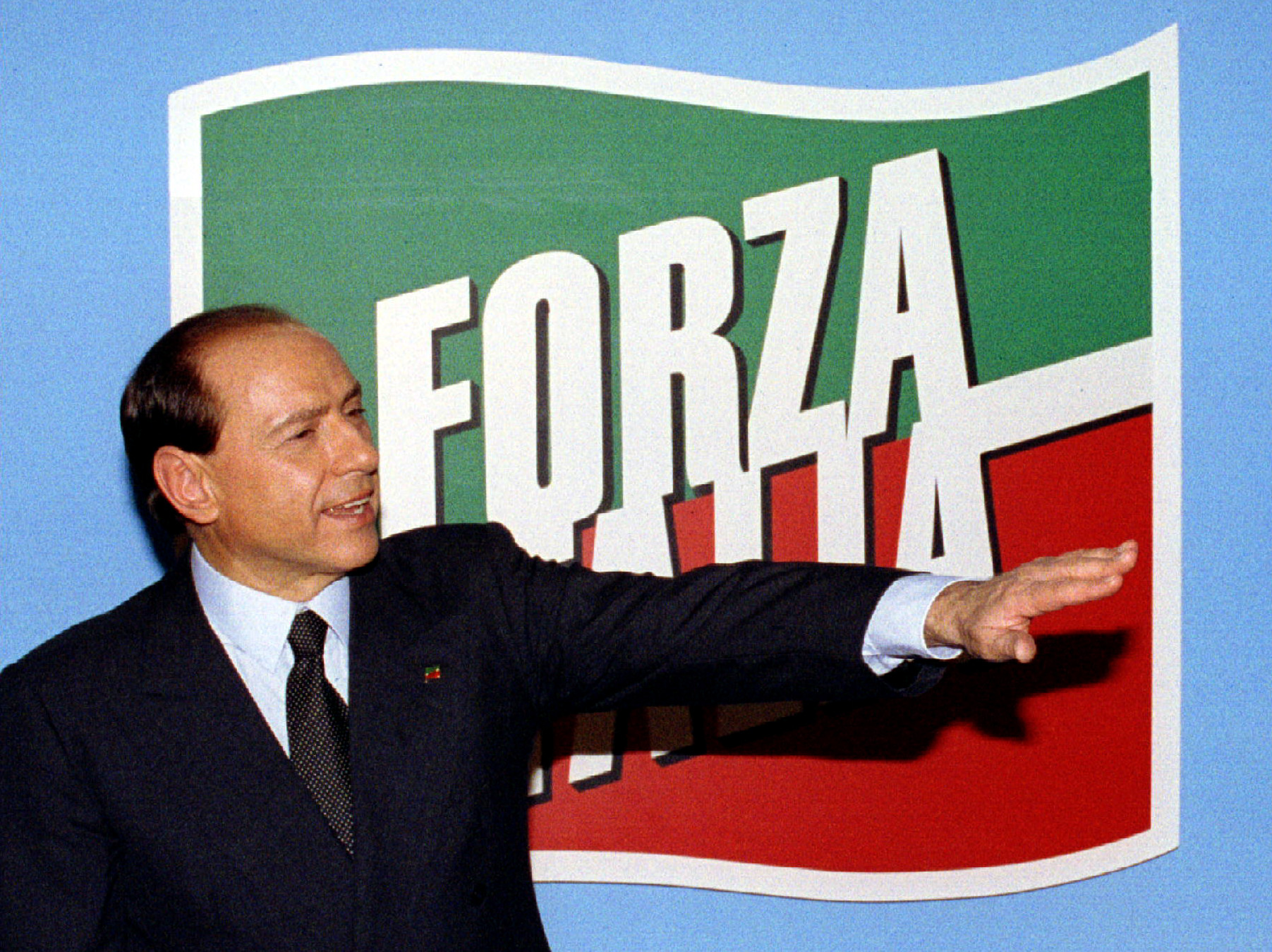 Silvio Berlusconi, leader of the right-wing Forza Italia (Go Italy) party and head of the Freedom Alliance gestures at his party's election headquarters after initial exit polls projected his party would win an absolute majority for Italy's 630-member chamber of deputies March 29