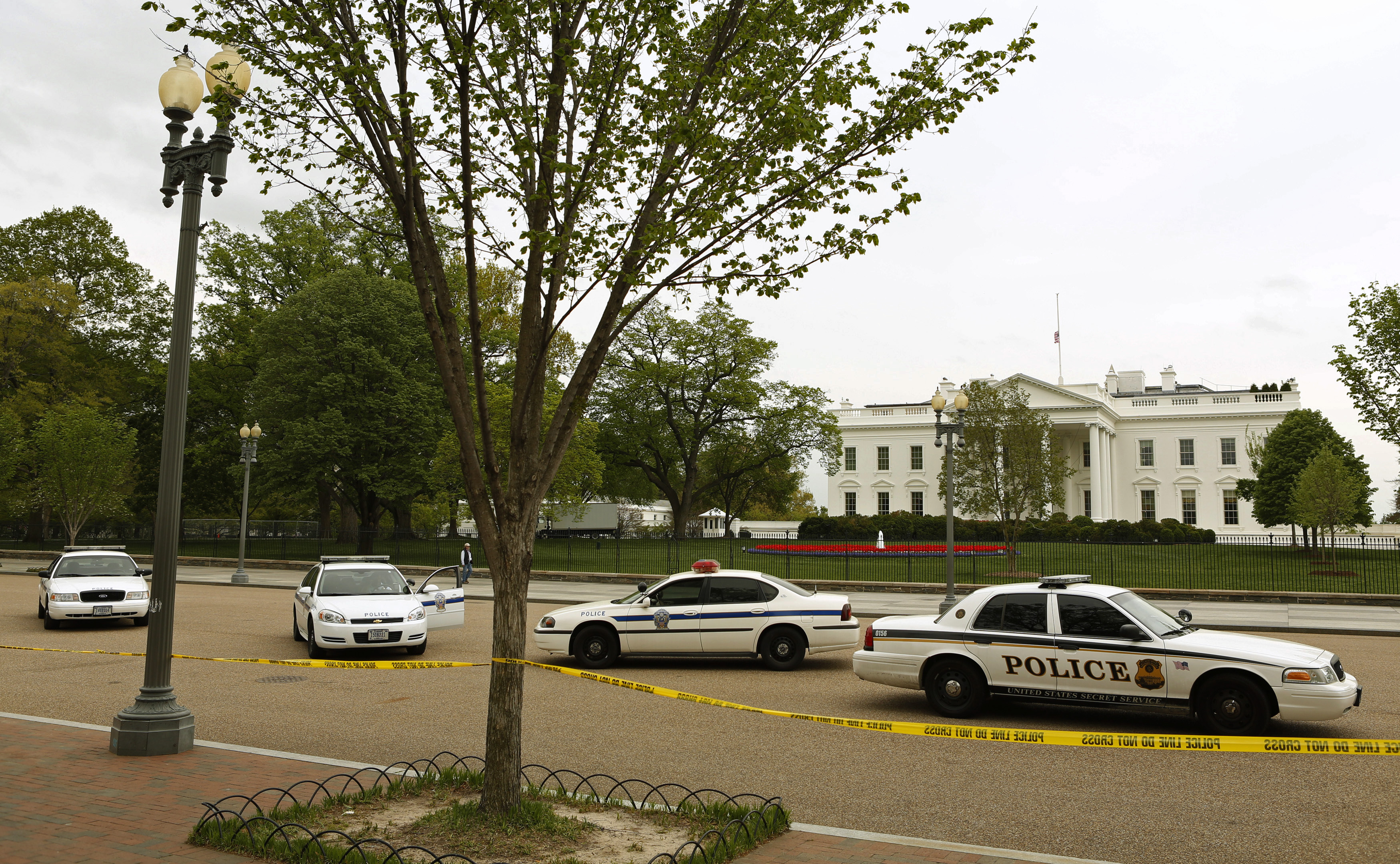 Police cars are parked in front of the White House as Pennsylvania Avenue remains closed to pedestrian traffic in Washington.