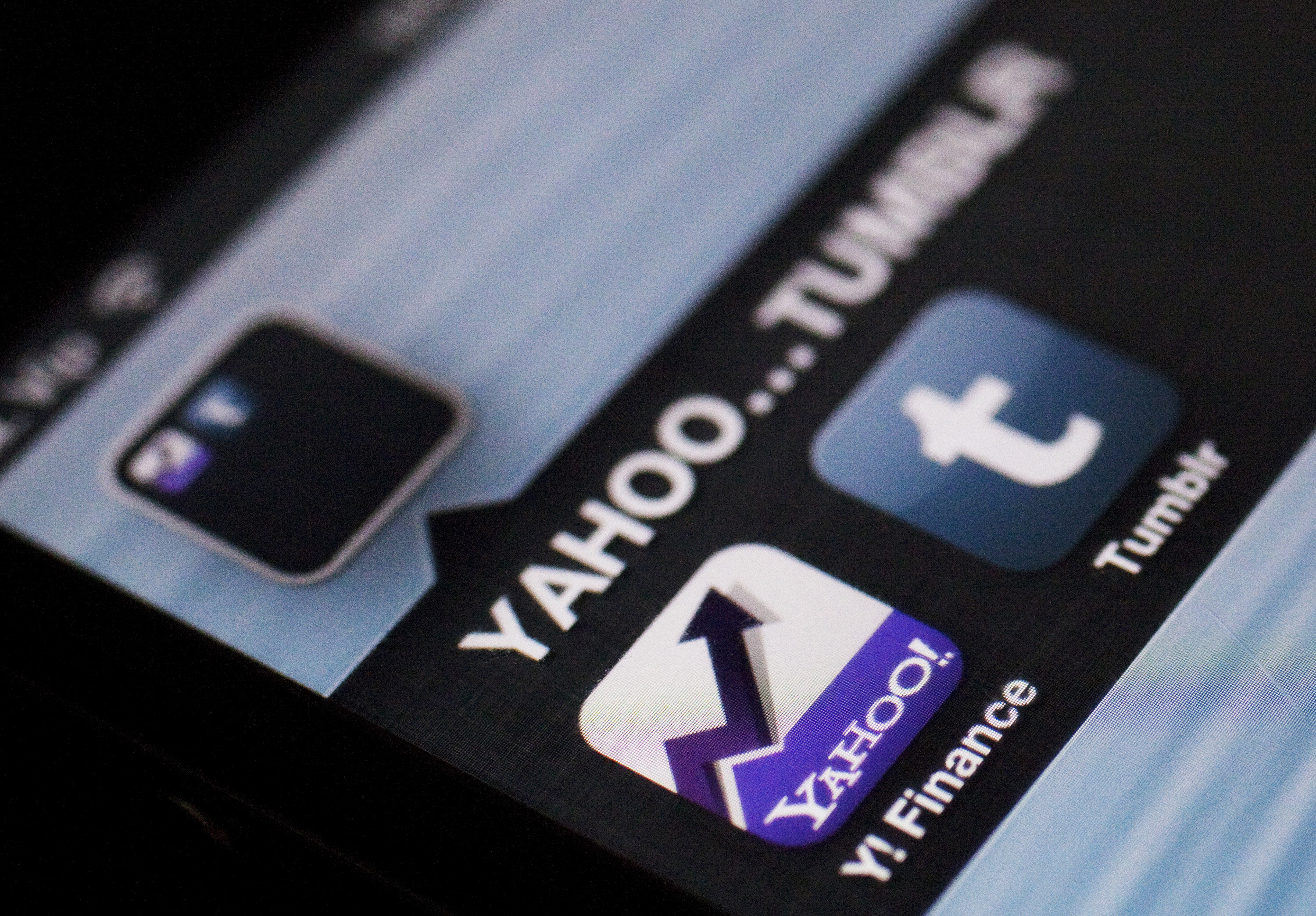 A photo illustration shows the applications of Yahoo and Tumblr on the screen of an iPhone in Zagreb May 20, 2013. Yahoo Inc said it is buying blogging service Tumblr for $1.1 billion cash, giving the struggling Internet pioneer a much-needed platform in social media to reach a younger generation of users. REUTERS/Antonio Bronic