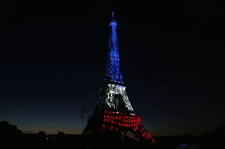 The Eiffel Tower is illuminated before the traditional Bastille Day fireworks display in Paris. ©Reuters