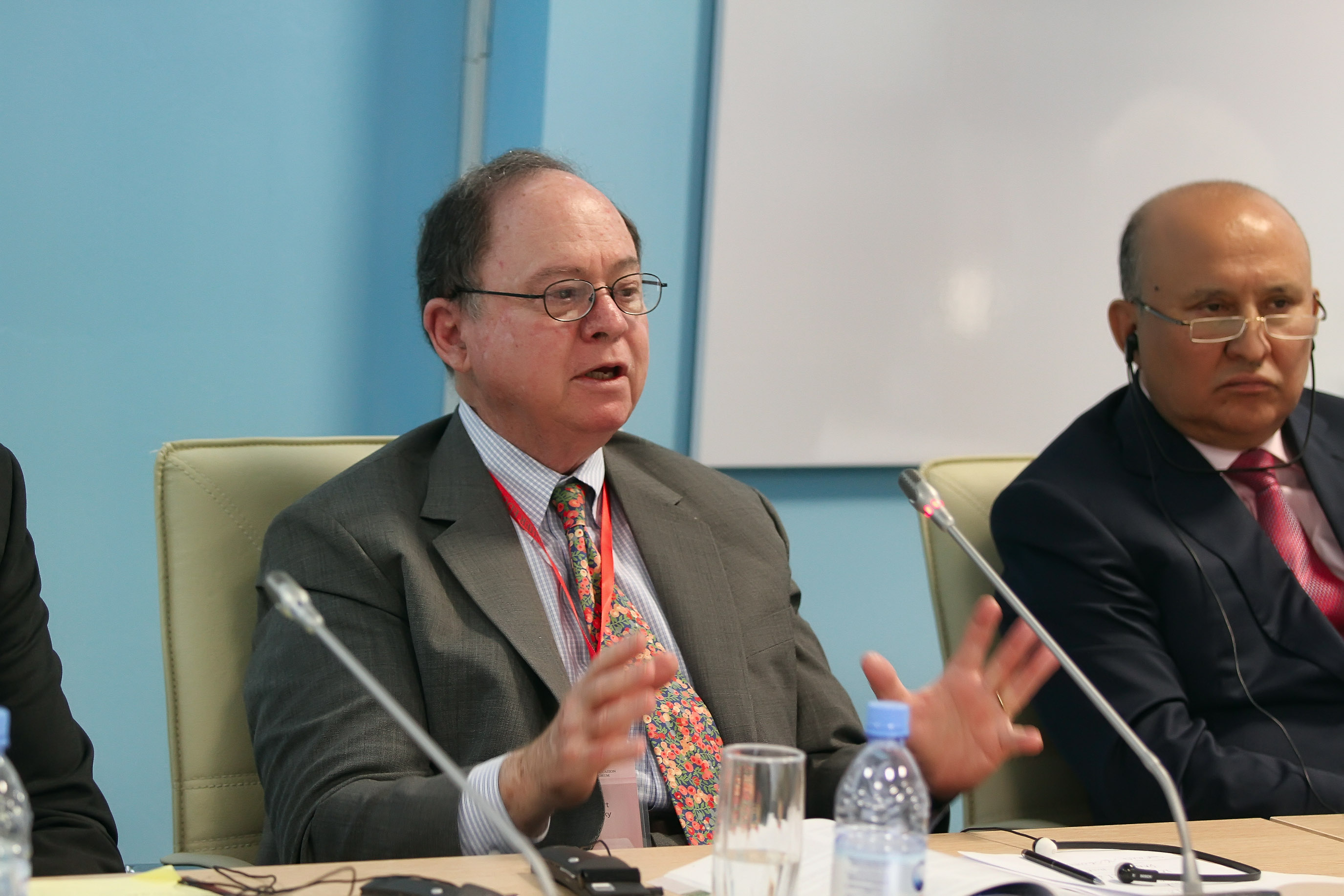 Professor Robert Zemsky of the University of Pennsylvania's Graduate School of Education moderates a conference panel on universities' public responsibility. Photo courtesy of Nazarbayev University.