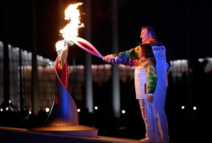 Russian torchbearers Irina Rodnina (L) and Vladislav Tretyak light the Olympic cauldron at the opening ceremony of the 2014 Winter Olympics on February 7, 2014, in Sochi. ©sochi2014.com