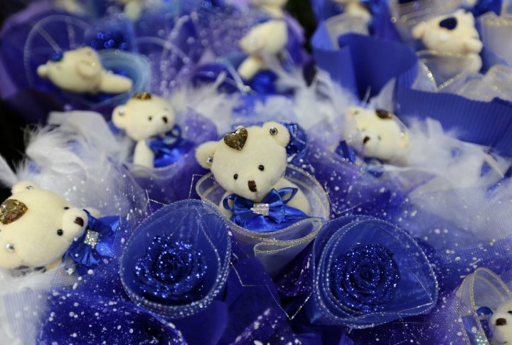 A bouquet made of blue roses and little teddy bears on sale on the Valentines Day in Beijing, China. ©Reuters