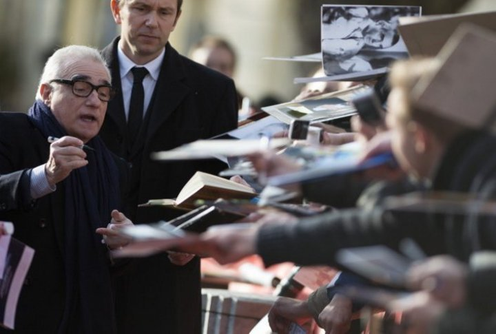 Film director Martin Scorsese dispensing autographs at the red carpet of the Berlinale. REUTERS©