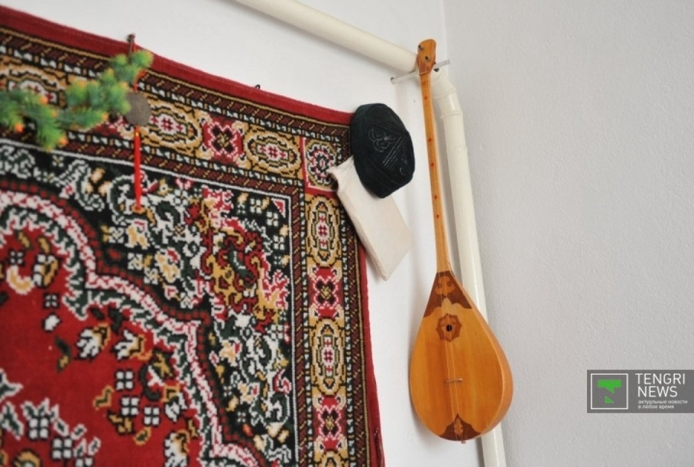In every Kazakh home there is a place for sacred Koran and a dombyra, Kazakh national musical instrument. ©Nurgisa Yeleubekov
