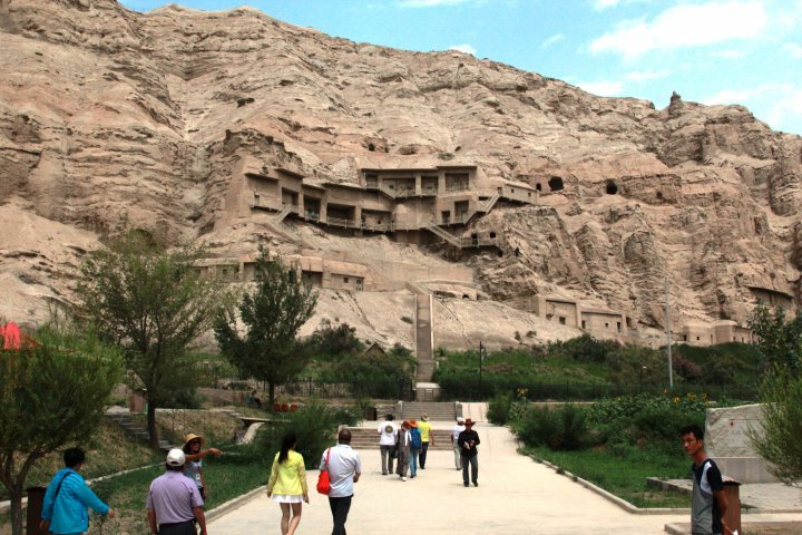 "Further, the group visited another Buddhist temple called ""Myn uy"" (translated as 'thousand houses"" from Uighur). It is also called the Thousand Buddha Caves and is a site of great many caves carved right into the mountain. ©Vladimir Prokopenko"