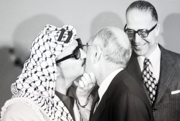 Yasser Arafat, chairman of the executive commission of Palestine Liberation Organization, meeting a visitor at the reception in the UN headquarters where he made his first address to the General Assembly. November 13, 1974. <br>UN Photo/Teddy Chen©