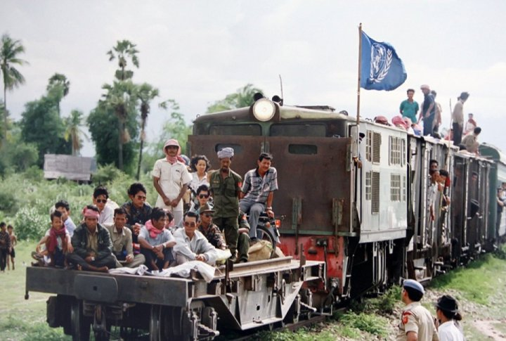 Cambodia refugees returning home from Thailand on a train provided by the UNHCR (UN Refugee Agency). June 1992. <br>UN Photo/Pernaca Sudhakaran©