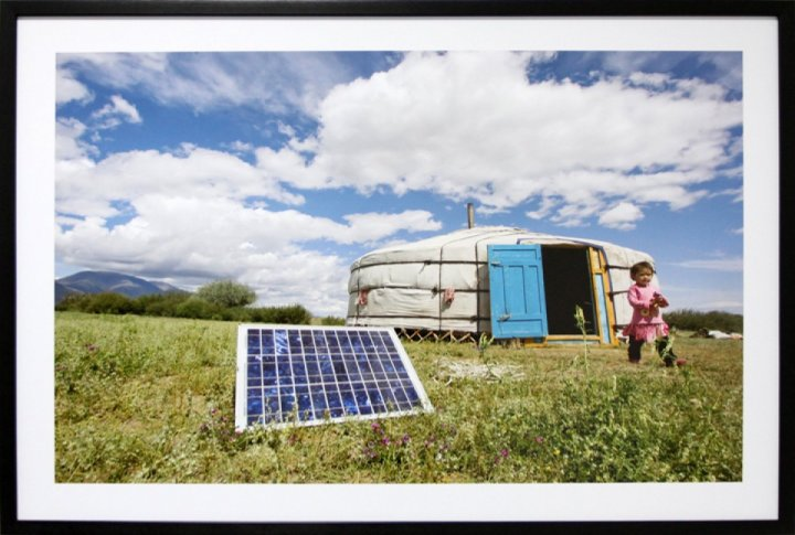 A family using solar panels to generate energy for their yurt, a traditional dwelling in Mongolia. July 28, 2009. <br>UN Photo/Eskinder Debebe©