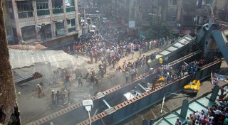 A picture posted on Twitter of the scene in Kolkata where a bridge has collapsed. @MetroTelegraph