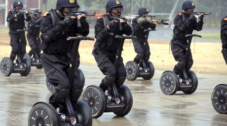 Members of China's armed police demonstrate a rapid deployment during an anti-terrorist drill in Jinan. Photo courtesy of boston.com