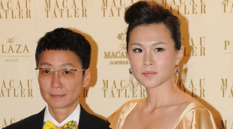 Gigi Chao (R), the daughter of Hong Kong tycoon Cecil Chao Sze-tsung with her partner. ©AFP